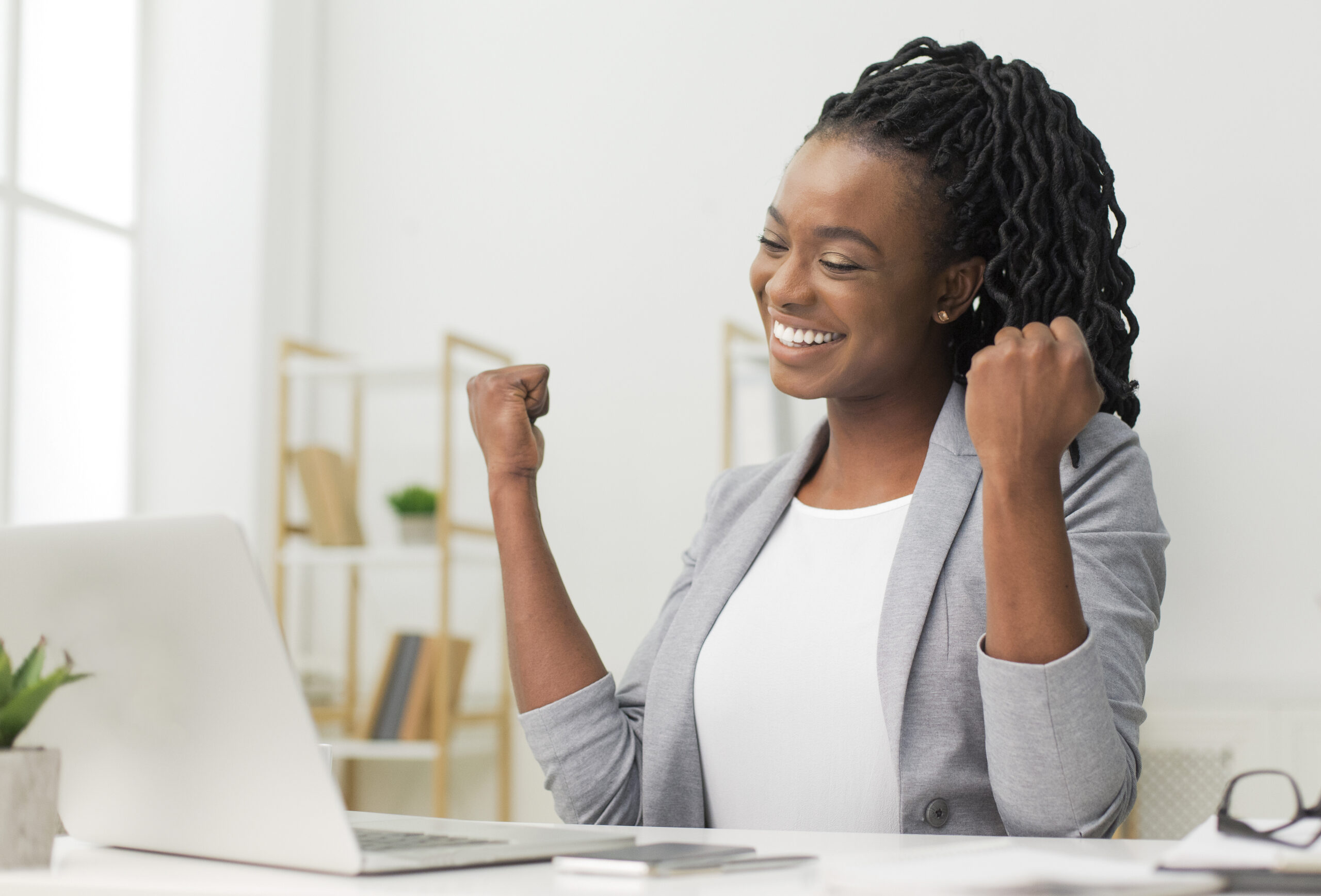 Black Lady Gesturing Yes Sitting At Laptop Celebrating Business Website Success In Modern Office